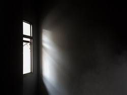 Light from window to the dark room with foggy. Mystery location. Scary. Alone. Mobile photography.