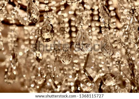 Light glistens off of the orbs of a crystal chandelier