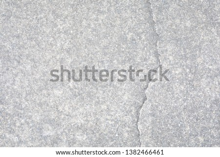 Light gray aggregate material with crack. Background material; #1382466461