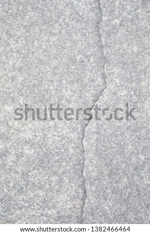 Light gray aggregate material with crack. Background material; #1382466464