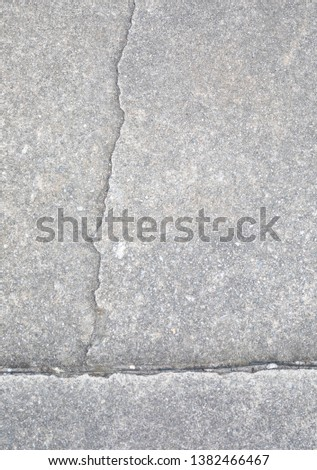 Light gray aggregate material with crack. Background material; #1382466467