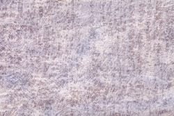 Light gray and pearl fluffy background of soft, fleecy fabric. Texture of ivory velveteen textile backdrop with shiny pattern, closeup.