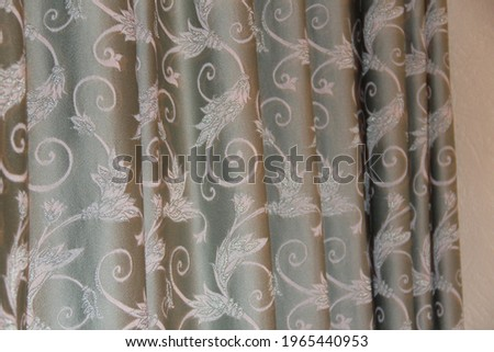 Light gray-green fabric with a white pattern. Pleats on the fabric. Backgrounds Stok fotoğraf ©