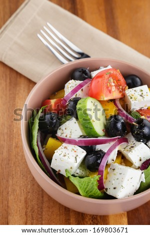 light greek salad, served in bowl with red onion #169803671