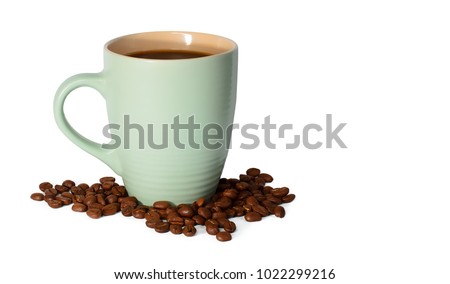 Photo of Light green clean cup with coffee and coffee beans isolated on white background. Image with free space for text