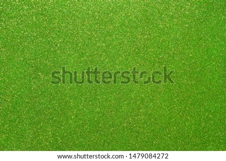 Light green glitter. Abstract shiny background. Design paper texture for decoration and design of Christmas, New Year or other holiday pictures. Beautiful packaging material.