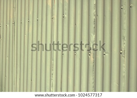 LIGHT GREEN PAINTED CORRUGATED IRON PLATES OVERLAPPING #1024577317