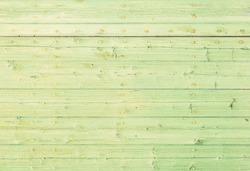 Light green wood background texture.