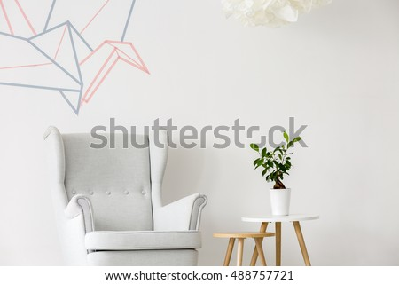 Light home interior with armchair, side table and washi tape wall decor #488757721