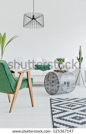 Light home interior with green chair, carpet and sofa #525367147