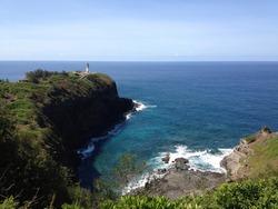 Light house over the blue ocean cliff at the Kilauea point, Kauai, Hawaii