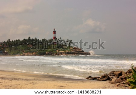 Light House  with Rock in Kerala, India #1418888291