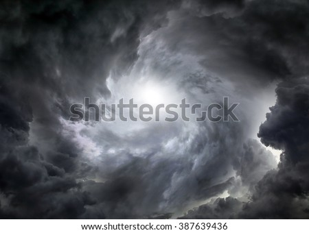 Photo of  Light in the Dark and Dramatic Storm Clouds