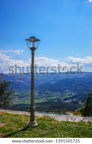 Light lamp on top of the mountain with a landscape view over a small village in Arouca, Portugal