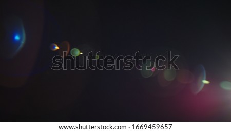 Photo of  Light Leak Cine Lens 20mm Lens Flares for Film and Movie. Bright Lens Flare flashes for Transitions, Titles. Light Pulses and Glows.