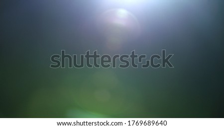 Photo of  Light leaks effect background animation stock footage. Lens light leaks flashing around making an elegant abstract background animation. Classic Light Leak in 4k