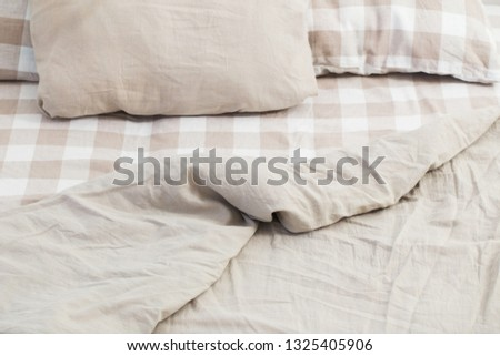 light linen bedclothes on bed #1325405906