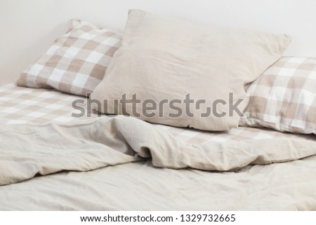 light linen bedclothes on bed #1329732665