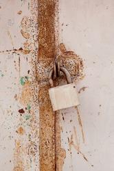 light lock on rusted iron doors