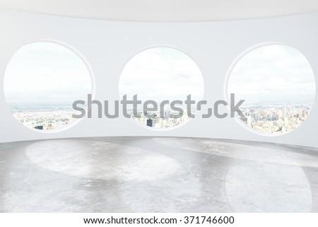 light loft room with round...