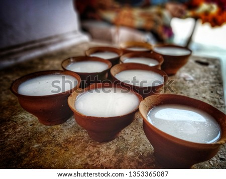 Light milk are being sold in the pool pot for worshipping the Shiva or pouring on the Shivalingam in Varanasi at Vishwanath Temple with copy space.
