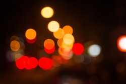 Light night at city orange bokeh abstract background blur lens flare reflection beautiful circle glitter lamp street with dark sky.