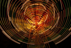 Light night in swing cycle at night in festival and cerebrated by background