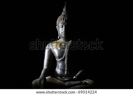 Light of Buddha image in the dark background. - stock photo