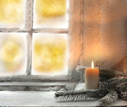 light of candle and window