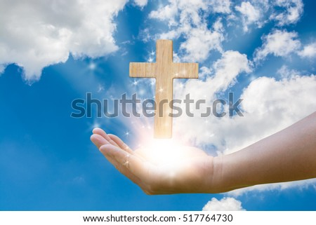 Light of God, Light and cross,Light from sky or heaven shine trough crucifix form,in hand
