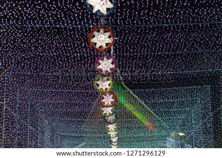 Light of star,light of Church,lamp of star,Chrismas Festival ,Tunnel of light,Star Wall in the night,at Ban Tha Rae,Sakon Nakhon,Thailand. #1271296129