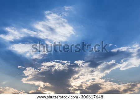 light of sunbeam on blue sky background with clouds and sun light
