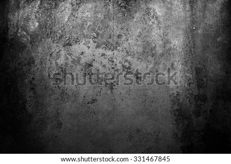 Light on grey wall. Black abstract background. black grunge background