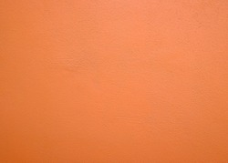Light orange wall Cement wall background.