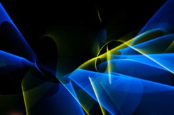 Light painting abstract background. Blue and yellow light painting photography, long exposure, ripples and swirl against a black background.