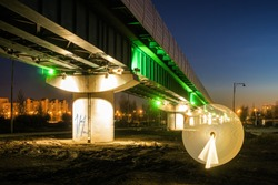 Light painting during sunset on the background of surface metro at the south of Moscow, Russia.