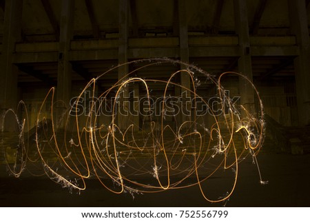 Stock Photo Light painting / light drawing with fire and steel wool