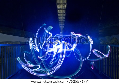 Light painting / light drawing with spotlight in the city #752557177