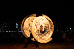 Light painting of a street performer of fire in Firelight festival at Docklands, Melbourne, Australia