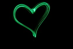 Light Painting Photography Heart Symbol against a black background