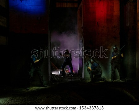 Light painting picture trying to create the scene of a police squad hunting a therrorist.