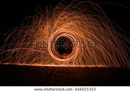 Stock Photo Light painting; Pyrotechnic display at night.