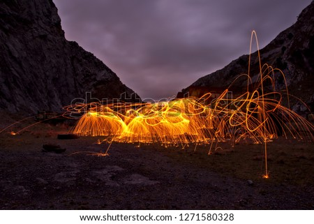 Light-painting spectacular picture. It was taken in an abandoned quarry where some of the trucks and machinery are still there.