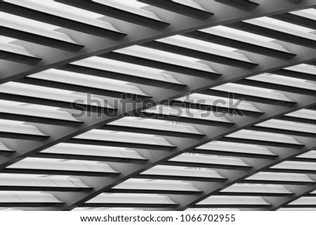 Light passing through grid structure. Tilt close-up photo of transparent roof lathing. Abstract modern industrial / office architecture fragment. #1066702955