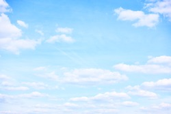 Light pastel blue sky with clouds, may be used as background