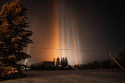 Light Pillars. Rare meteorological phenomena. Winter nature landscape.