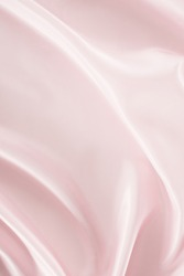 light pink crumpled satin fabric background