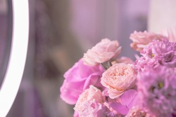 Light pink, purple, peach colour, white cute delicate small roses of different sizes, flowers in a lush bouquet. Close-up. Concept photo shooting