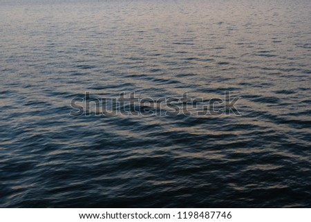 Light playing on the sea surface. Water surface. Sea surface. Water background. Blue water surface. Abstract blue water