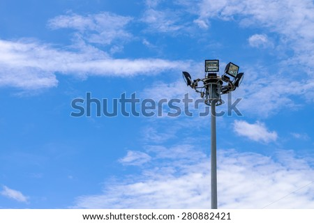 light pole and blue sky with clouds